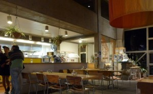 Residents linger in the Craft III café at night.